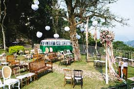 backyard weddings eclectic backyard wedding ceremony different chairs hanging poufs