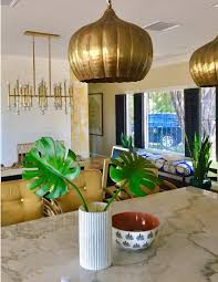 house updates kitchen eat dining area jill sorensen loads mid century gold fixtures and quartzite stone tops when bought the house kitchen wall was right behind where you see bar stools