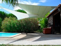 exterior contemporary cream shade sails design with pool for