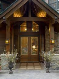 front door lighting ideas with glass door and lamps and flowers