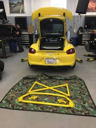 porsche dealership racing yellow porsche 981 cayman gt4 bbi roll bar u0026 schroth racing
