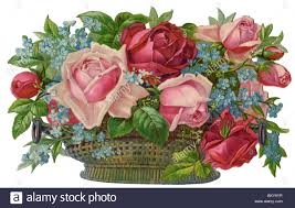 pink roses red roses and forget me nots in a wicker basket stock