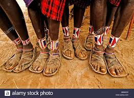 maasai people close up of leather sandals and intricate beadwork