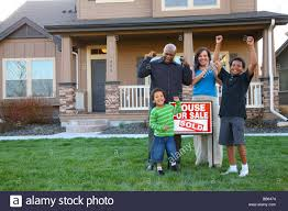 african american family celebrates new home purchase stock photo
