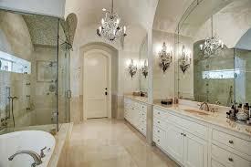 luxury master suite bathroom with elegant crystal chandelier