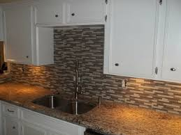 st cecilia granite with tile backsplash breaking bread