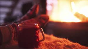 feet in woollen socks by burning christmas fireplace 4k