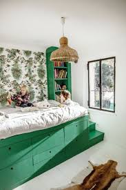 kids bedroom designs green kids bedroom with raised bed and storage underneath kids