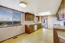 empty kitchen room with linoleum floor old storage cabinets