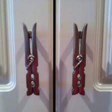 laundry room cabinet knobs clothespins cabinet pulls cute idea for a laundry room diy craft