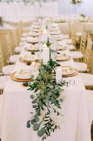wedding centerpieces for round tables lush garden wedding with greens galore lush garden photography