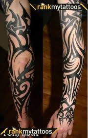tribal black ink fire and flame tattoo on man sleeve mike