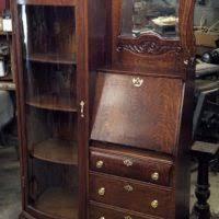 brown wooden drop front secretary desk with glass door case and