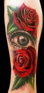 roses and amazing eye on arm tattoomagz