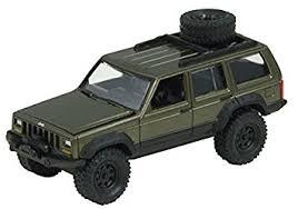 jeep cherokee toy amazon com johnny lightning 1 64 scale dark green jeep cherokee off