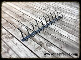 forged coat rack 10 double hooks rustic hand forged signed forged coat rack 10 double hooks rustic hand forged signed by blacksmith naz black powder coated for inside or oustside