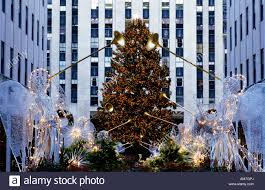 christmas tree and trumpet angels decoration at rockefeller