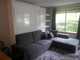 cabin wall bed sofa installation in whistler canada expand