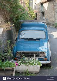 An Old Blue Renault 4 With Roof Rack In The Village Of Bugarach