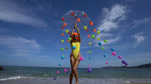 Futuristic Style Woman In Modern Futuristic Style Posing With Coloured Balls
