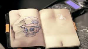 book made of synthetic skin lets beginner tattoo artists practice