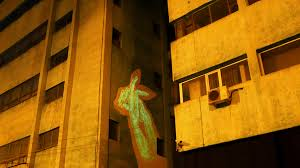 spectacular glow in the dark street murals reveal hidden meanings