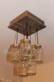 Diy Recycled Home Decor Diy Pallet And Mason Jar Light Mason Jar Lighting Jar Lights