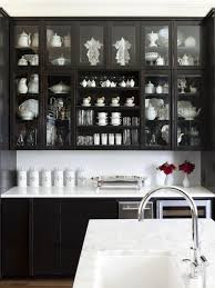 white marble top with black glass cabinet doors for fantastic
