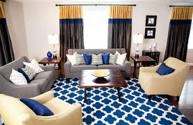blue living room rugs blue and yellow area rug living room modern with gallery wall dark