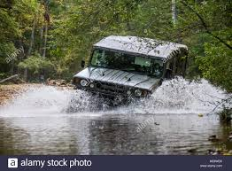motor cars toyota suv motor car toyota mega cruiser driving on a forest stock photo