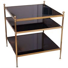 black side table with shelf gilt bronze side table with black glass shelves attributed to