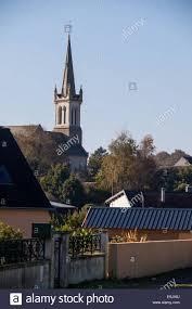 haphazard haphazard roof tops around church steeple stock photo royalty