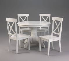 furniture docksta table in white with chairs and area rug for