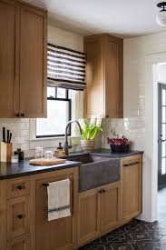 modern country kitchen with oak cabinets wood cabinets in the kitchen a comeback town