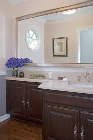 louvered framed mirrors bathroom traditional with white wood metal
