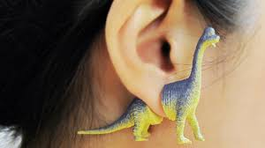 dinosaur earrings take your lobes to the jurassic era with these plastic dinosaur