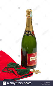 bottle of piper heidsieck champagne at christmas with a red gift