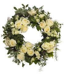 white wreath delivered with care designed with