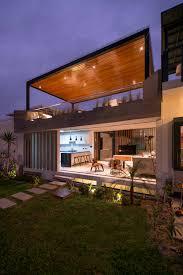 contemporary concrete home with lush green garden in summer 3d