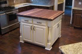 white kitchen island with butcher block top kitchen idea
