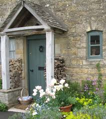 old english country cottage showing door and porch repinned by