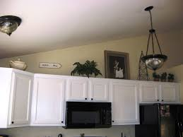 Space Above Kitchen Cabinets Ideas Decorating Above Kitchen Cabinets With High Ceilings Gallery And