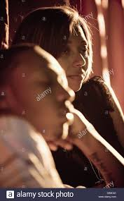 profile of young couple in dimly lit room stock photo royalty