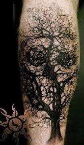 tree skull design on leg tattoos