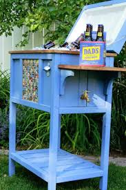 make your own diy cooler stand with a drain shelf and wheels
