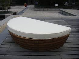 half round outdoor rattan daybed with white cushion and pillow