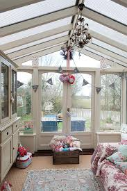small cozy and light filled family room sun room homey