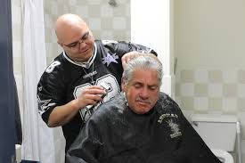 interfaith community services local barber gives back in a