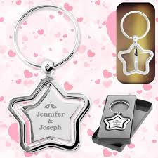 wedding favor keychains customized silver stella spinner wedding favors keychains