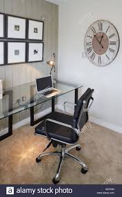 show home interior study office desk laptop glass desk clock on
